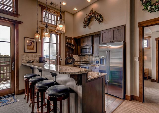 with seating for 4 at Kitchen Bar - great place to gather with your group after a day of fun at the Breckenridge Ski Resort