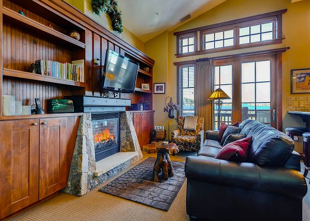 cozy fire in living room overlooking the ski area!
