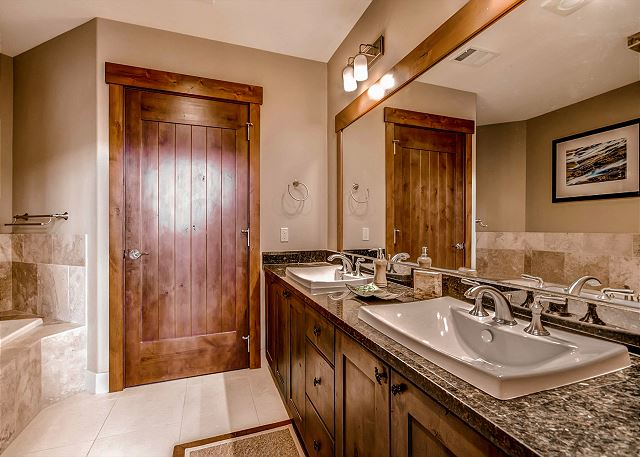 with tub, walk in steam shower and double sinks