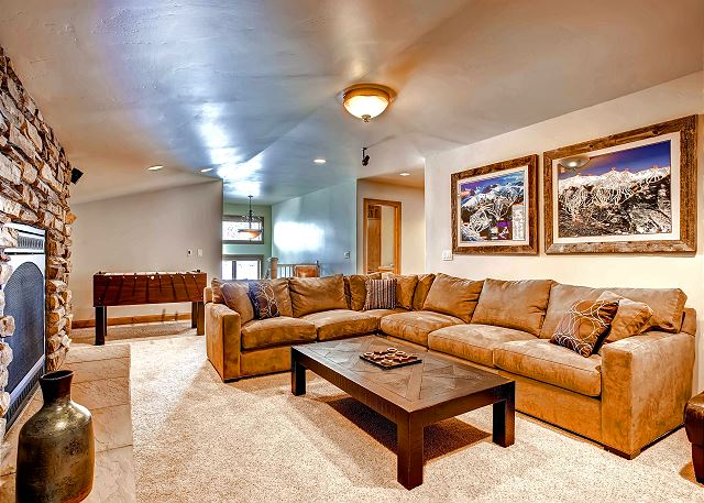 entertains with cozy couch, foosball, and large TV