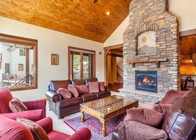 with warm fireplace and access to upper deck