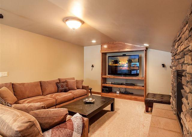with TV, Gas Fireplace and Foosball (not shown).  Comfy sofa converts into a queen sleeper for two.
