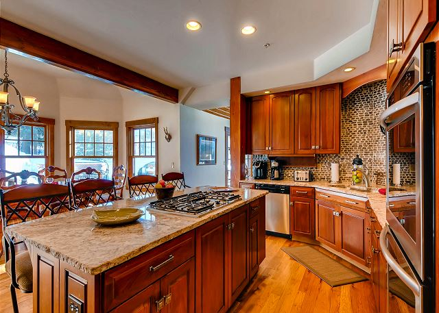 Kitchen with Island Cooktop and seating - open to dining area