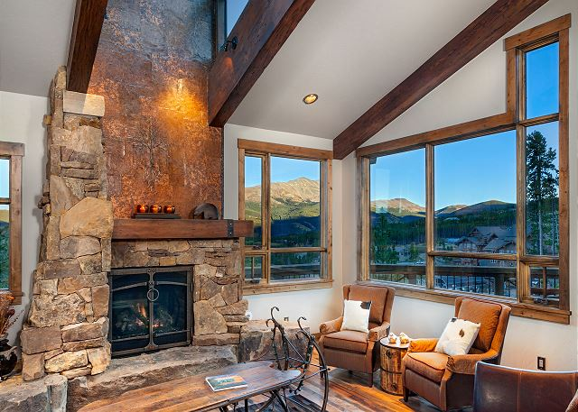 with mine shaft centerpiece architecture and copper mine shaft chimney above gas fireplace - lots of sunny windows and skylights. Living room is open to the gourmet kitchen.