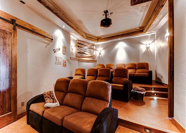 off lower level rec room with mining theme has recliners for 12, cork flooring and specialty acoustics for the best sound. In the corner is a faux mine tunnel with recycled nails from the Breck Flume.