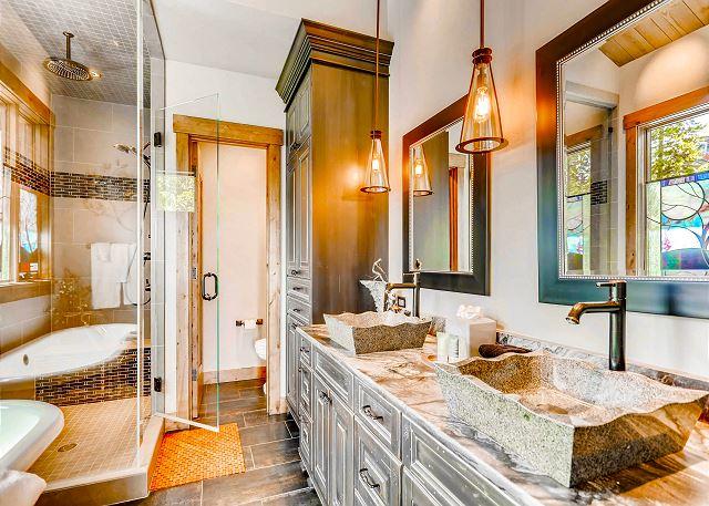 ensuite bathroom with dual sinks