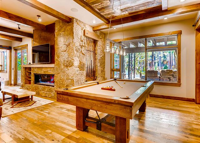 billiards with large wet bar and comfy couch relaxation options. Just adjacent to this room, find the soundproof theater room!