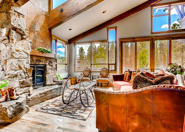 living room with fireplace and open concept to kitchen and dining on main level