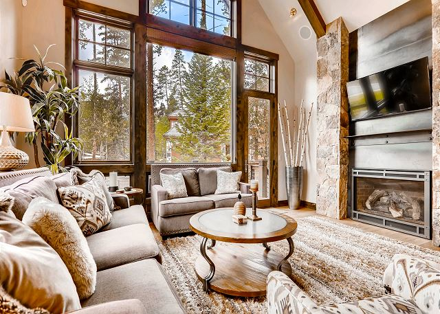 with gas fireplace, TV, cozy sofas and deck access