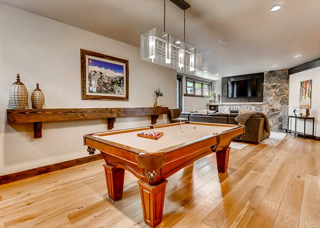 next to wet bar and lower den for perfect entertaining qualities