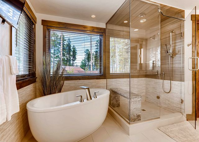 ensuite freestanding soaking tub and steam shower