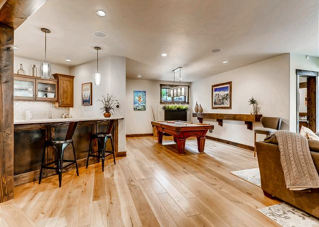 with pool table, cozy sectional, wet bar and TV!