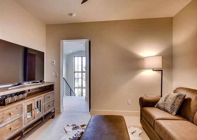 features privacy with the ability to close off the room, a large TV and queen sleeper sofa for 2