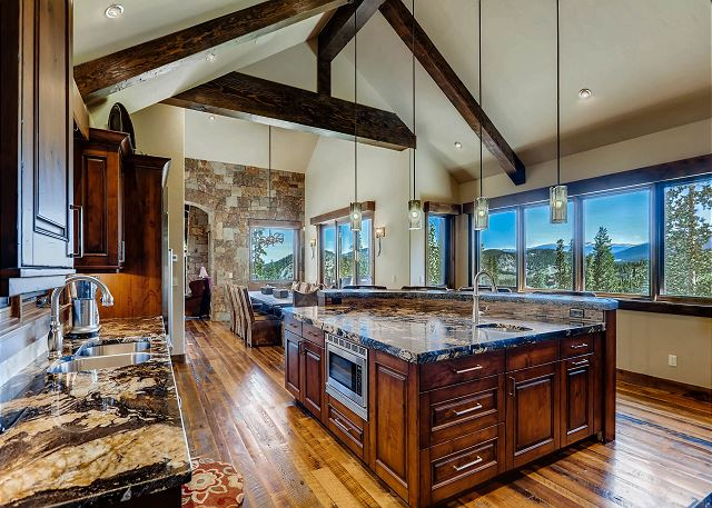 kitchen features all the right amenities, views, and additional seating