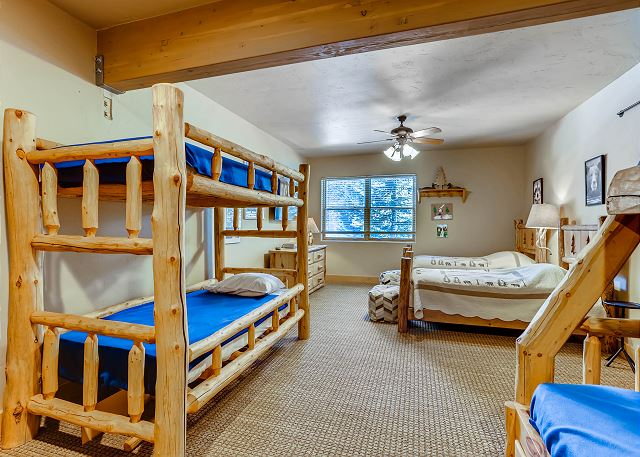 One captain's bunk (queen on bottom twin on top), one twin bunk bed (two twin beds), two twin beds, adjacent hall bathroom
