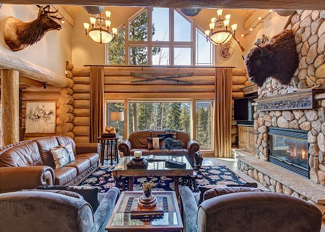 Take in mountainous views while relaxing near the fire in the main level great room.