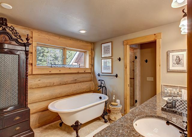 with soaking tub, separate shower, and dual sinks