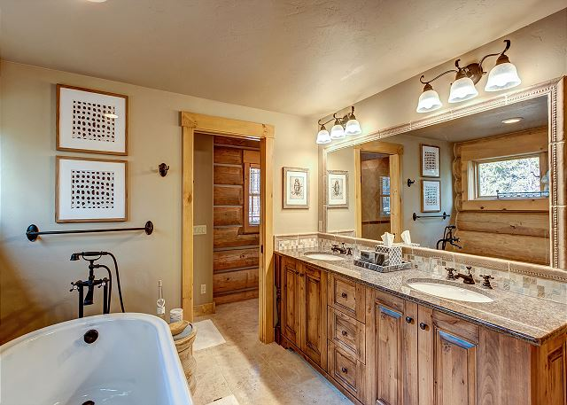 with soaking tub, separate shower and dual sinks