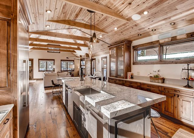 with farmhouse sink, granite counter tops and high end stainless steel appliances
