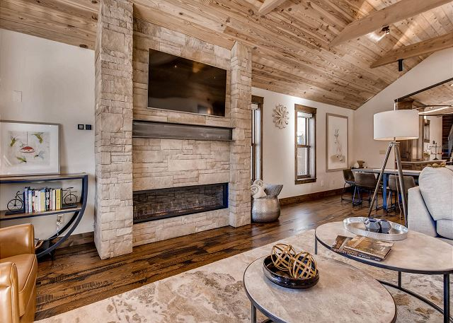 features TV and ambient fireplace.
