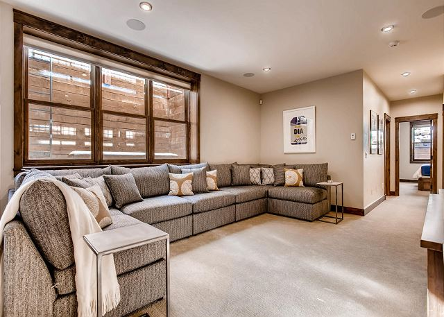 with large cozy sectional sofa and large TV with multiple cable viewing options