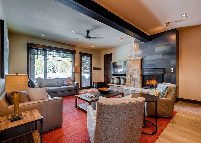 with a warm fire for cold days and quick access to the wet bar area with full size refrigerator