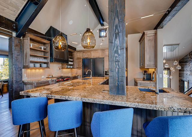 Gourmet kitchen with additional bar seating to enjoy conversations while the cook works their magic