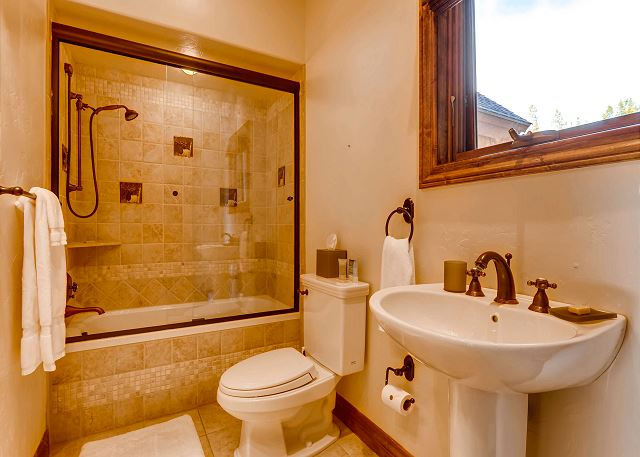 Full bathroom on main level adjacent to office and lounge