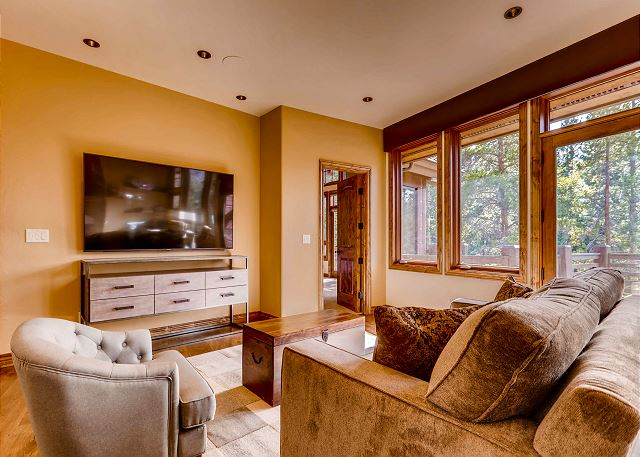 Cozy and entertaining lounge adjacent from great room featuring a 75 inch TV with cable, movie streaming and more!