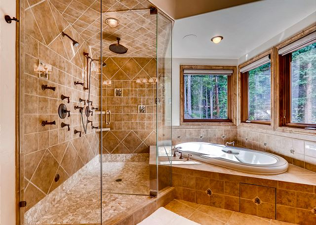 King of the North Ensuite Bathroom with dual shower heads and large tub