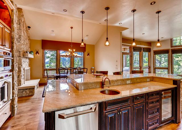 Kitchen with bar seating and open to dining