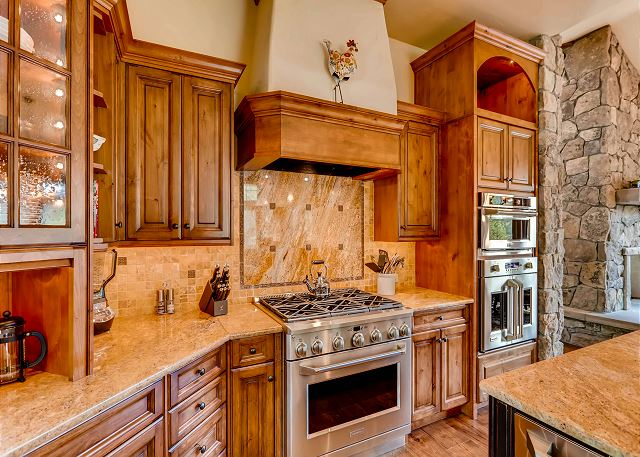 Gourmet full kitchen with 6 burner gas cooktop and dual wall oven