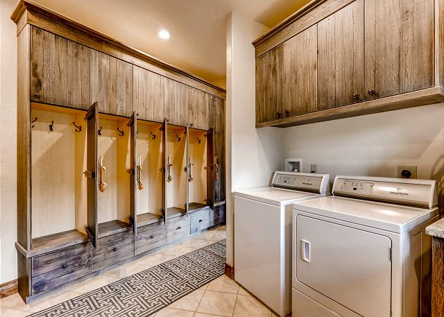 Mudroom and laundry area located off the top level garage entry