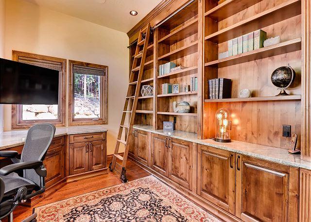 Main level office with plenty of storage options