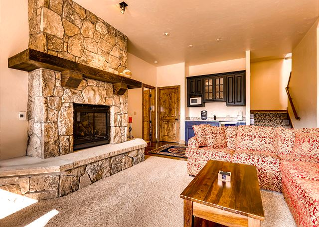 Spacious lower level den with warm fireplace, wet bar, and shuffle board!