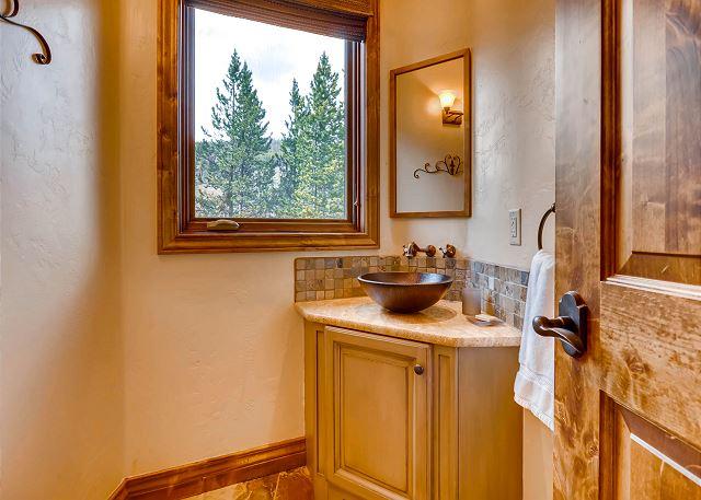 Convenient powder bath off mudroom before entering nook area