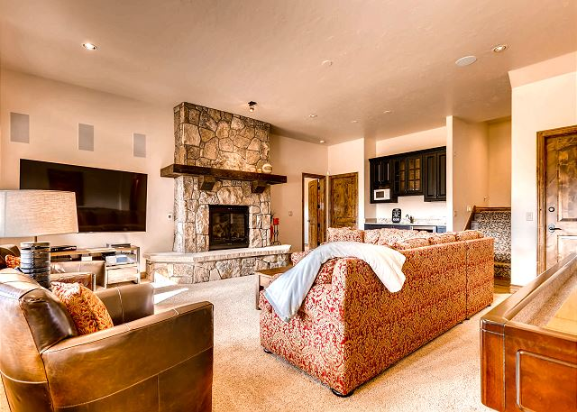 Lower level spacious den with large 75 inch; TV featuring plenty of entertainment options!
