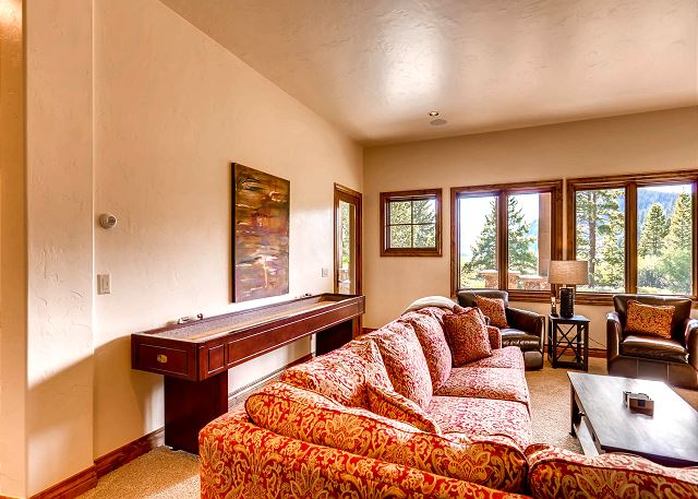 Spacious lower level den with shuffle board and outside patio access
