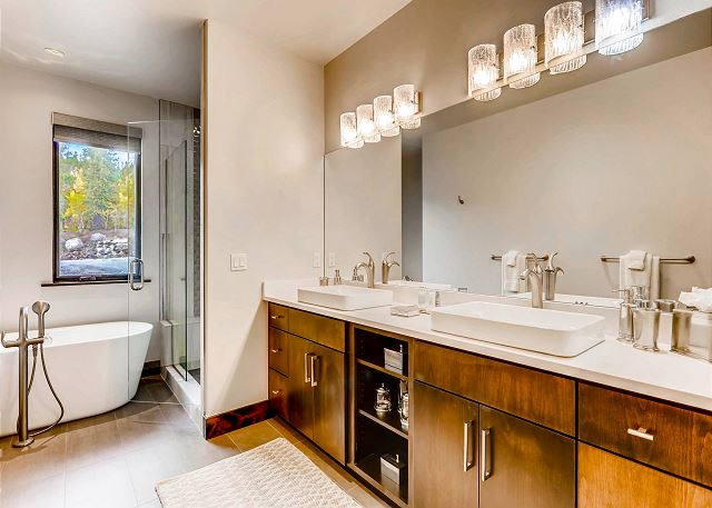ensuite bath with soaking tub, dual sinks and large walk-in shower