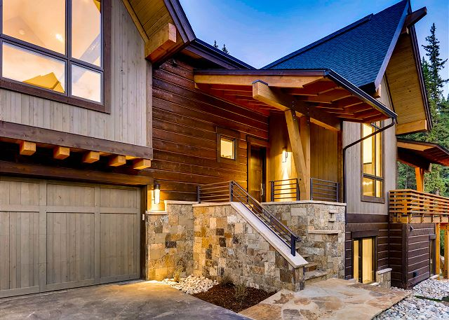 featuring 2 bay heated garage and front door access to main level