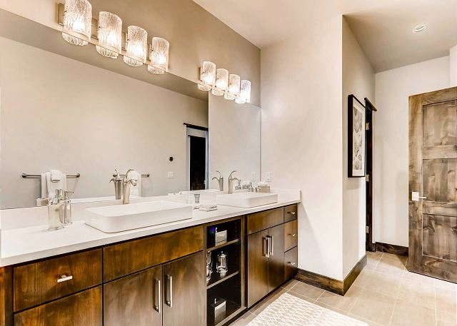 ensuite dual sinks and European style lavatory