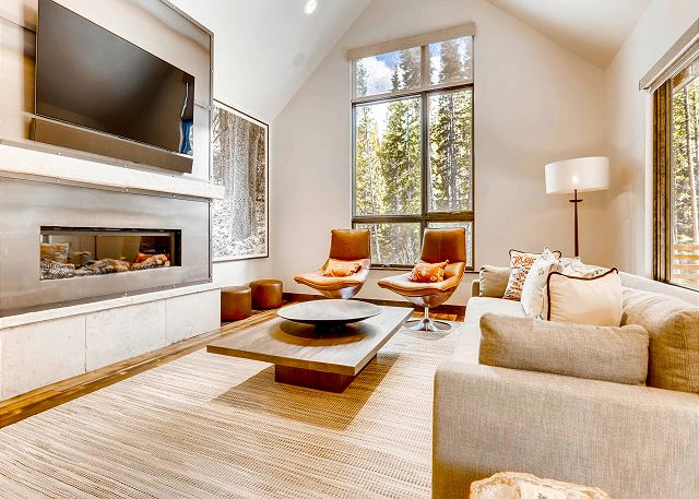 living room with private scenery of the Blue River, Smart TV, and gas fireplace