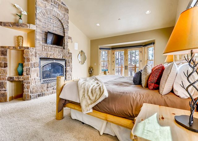 - sleeps 2 in one king bed and features TV, gas fireplace and upper deck access