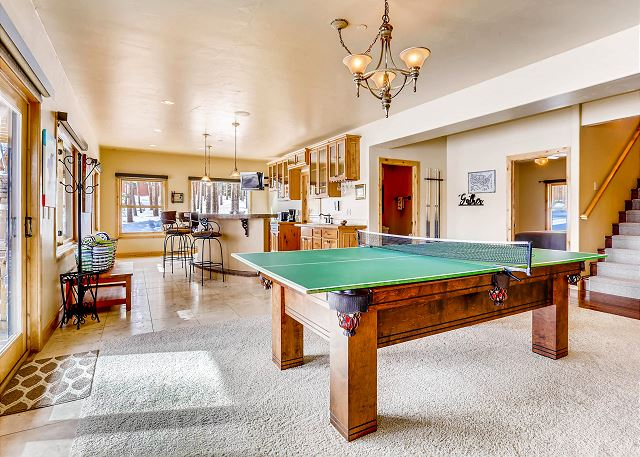 which features a table that converts between a game of pool or ping-pong