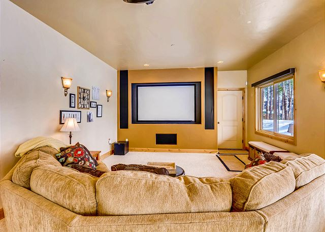 from the large projection TV and relax on the comfy sectional