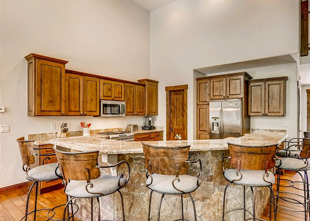 complete with bar seating for 6, ample counter space, and necessary utensils for perfecting every meal
