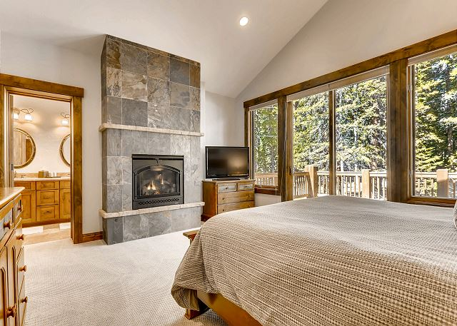 features fireplace, deck access and TV