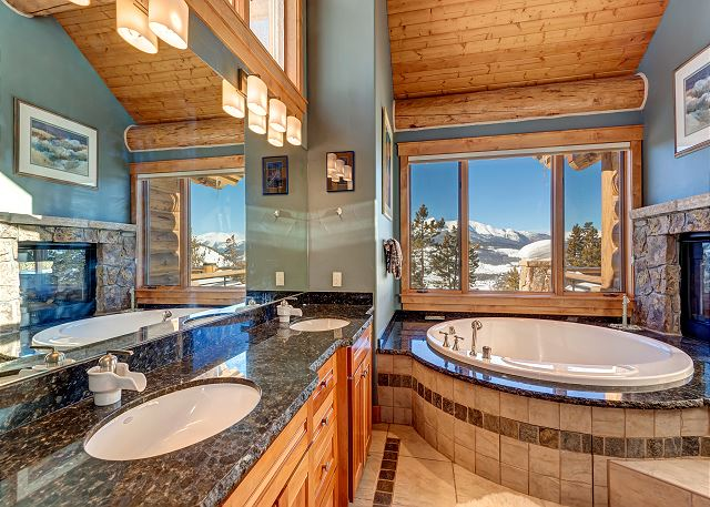 bathroom with dual vanity and standing shower with steamer. We apologize, the bathtub is not available for guest use.