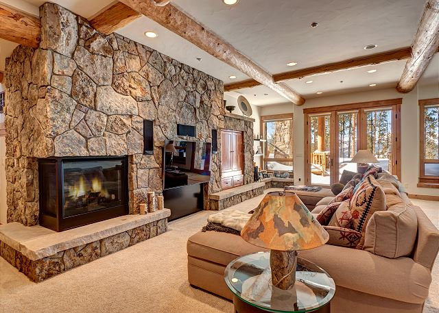 area entertains with comfy seating, Sonos and Xfinity, patio access and warm fireside