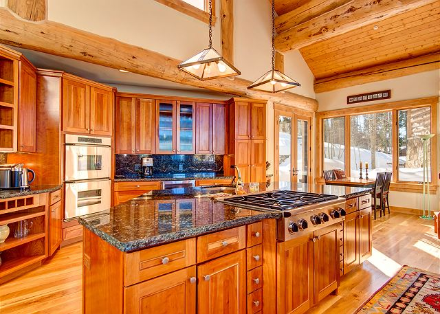 the 6-burner gas stove and dual ovens in this lustrous kitchen